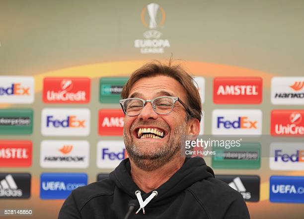 Jurgen Klopp manager of Liverpool laughs during a press conference ahead of the UEFA Europa League SemiFinal Second Leg match against Villarreal at...