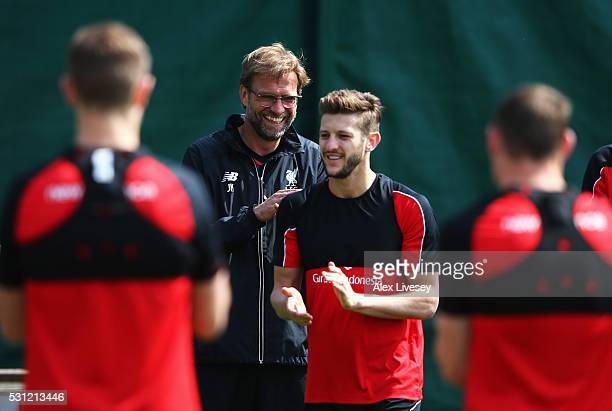 Jurgen Klopp manager of Liverpool laughs with Adam Lallana during a training session at the Liverpool UEFA Europa League Cup Final Media Day at...