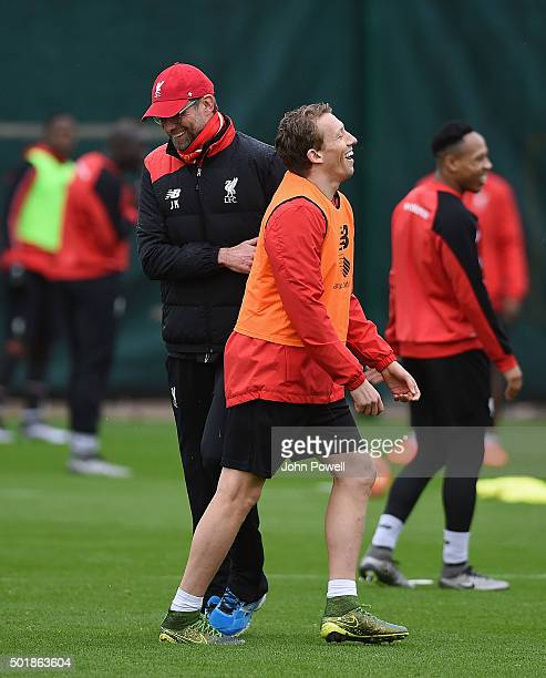 Jurgen Klopp manager of Liverpool laughs with Lucas Leiva during a training session at Melwood Training Ground on December 18 2015 in Liverpool...