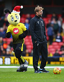 Jurgen Klopp manager of Liverpool looks on alongside Watford mascot Harry the Hornet prior to the Barclays Premier League match between Watford and...
