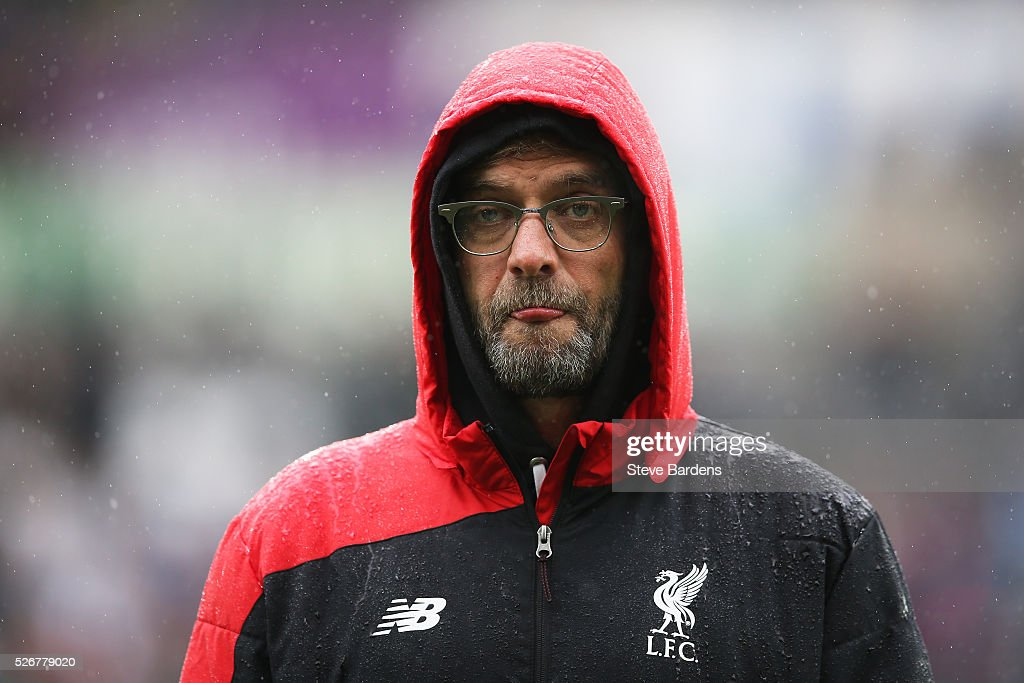 Jurgen Klopp, manager of Liverpool looks on as the team's warm up prior to the Barclays Premier League match between Swansea City and Liverpool at The Liberty Stadium on May 1, 2016 in Swansea, Wales.
