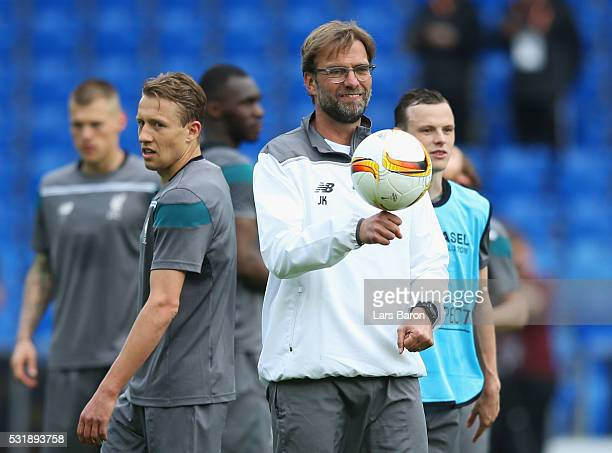 Jurgen Klopp manager of Liverpool looks on with Lucas Leiva during a Liverpool training session on the eve of the UEFA Europa League Final against...