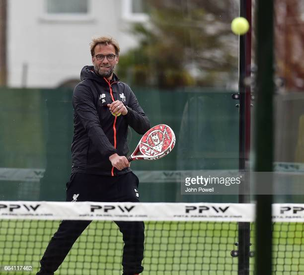 Jurgen Klopp manager of Liverpool playing paddle tennis during a training session at Melwood Training Ground on April 3 2017 in Liverpool England