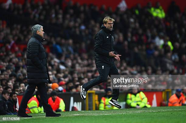 Jurgen Klopp manager of Liverpool reacts as Jose Mourinho manager of Manchester United looks on during the Premier League match between Manchester...