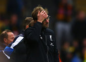 Jurgen Klopp manager of Liverpool reacts as Odion Ighalo of Watford scores their third goal during the Barclays Premier League match between Watford...