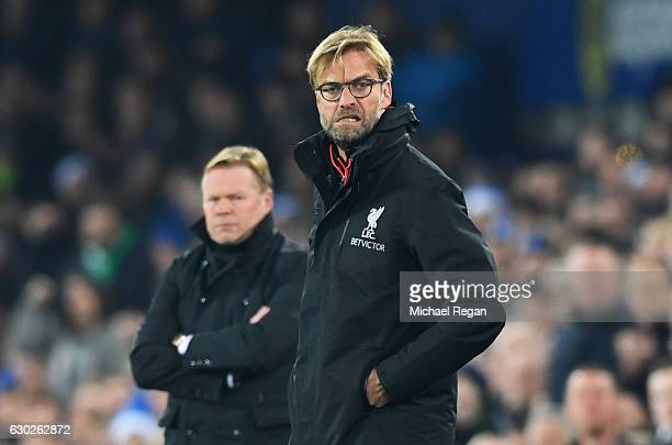 Jurgen Klopp manager of Liverpool reacts as Ronald Koeman manager of Everton looks on during the Premier League match between Everton and Liverpool...