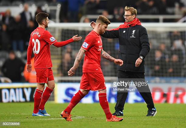 Jurgen Klopp manager of Liverpool shake shands with Adam Lallana after defeat in the Barclays Premier League match between Newcastle United and...