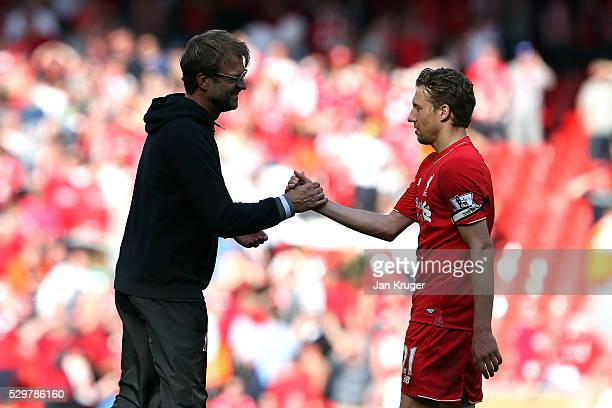 Jurgen Klopp manager of Liverpool shakes hand with Lucas following the Barclays Premier League match between Liverpool and Watford at Anfield on May...