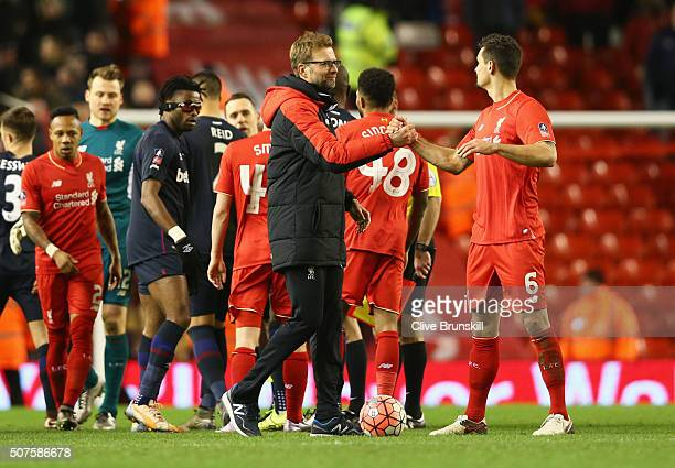 Jurgen Klopp manager of Liverpool shakes hands with Dejan Lovren of Liverpool after the Emirates FA Cup Fourth Round match between Liverpool and West...