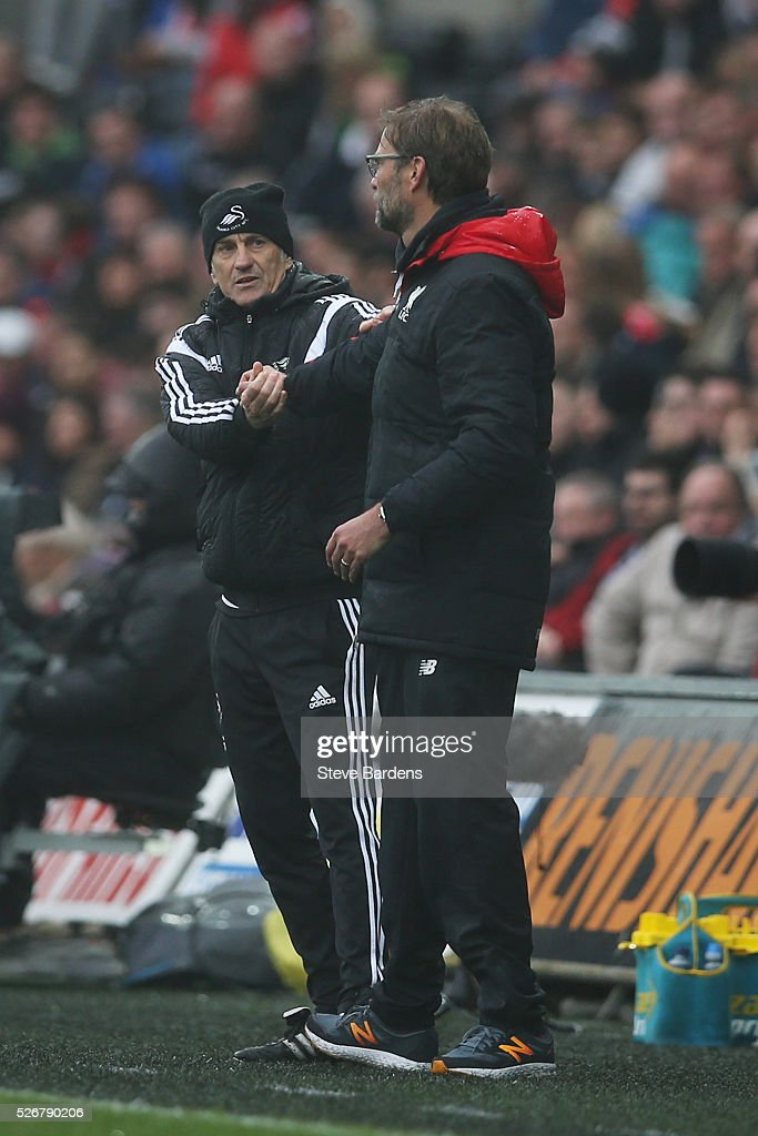 Jurgen Klopp (R), manager of Liverpool shakes hands with <a gi-track='captionPersonalityLinkClicked' href=/galleries/search?phrase=Francesco+Guidolin&family=editorial&specificpeople=770478 ng-click='$event.stopPropagation()'>Francesco Guidolin</a>, manager of Swansea City after the Barclays Premier League match between Swansea City and Liverpool at The Liberty Stadium on May 1, 2016 in Swansea, Wales.