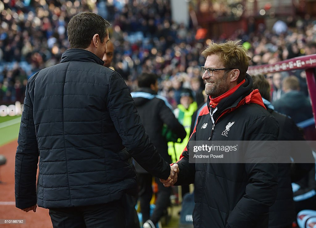 Jurgen Klopp manager of Liverpool shakes hands with Remi Garde manager of Aston Villa at the start of the Barclays Premier League match between Aston Villa and Liverpool at Villa Park on February 14, 2016 in Birmingham, England.