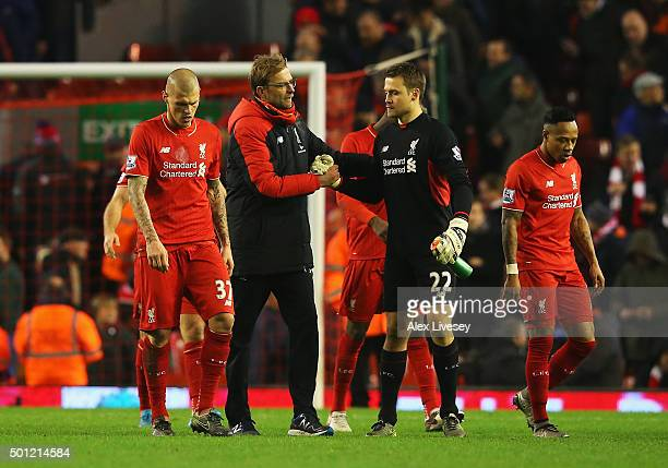 Jurgen Klopp manager of Liverpool shakes hands with Simon Mignolet of Liverpool after the Barclays Premier League match between Liverpool and West...