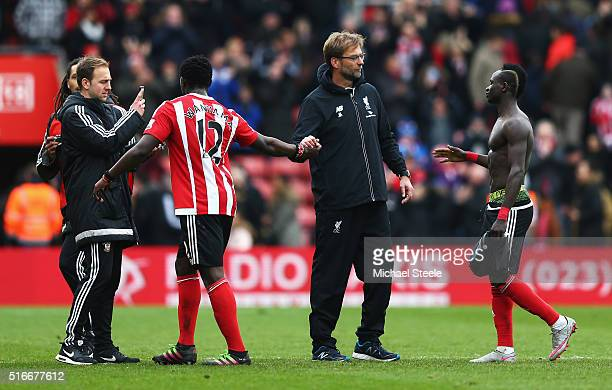 Jurgen Klopp manager of Liverpool shakes hands with Victor Wanyama and Sadio Mane of Southampton after the Barclays Premier League match between...