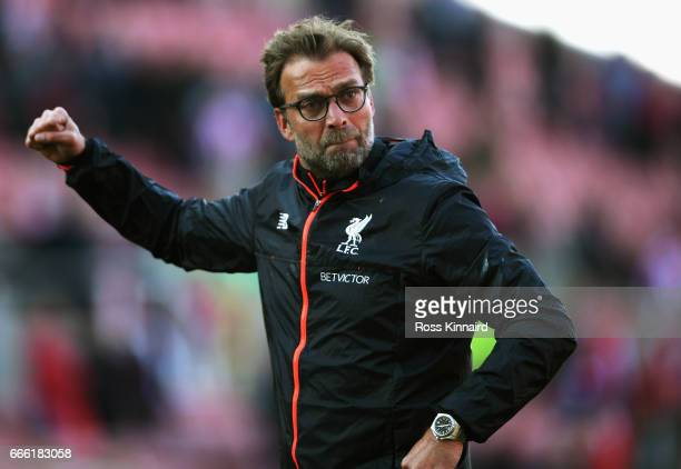Jurgen Klopp Manager of Liverpool shows appreciation to the fans after the Premier League match between Stoke City and Liverpool at Bet365 Stadium on...