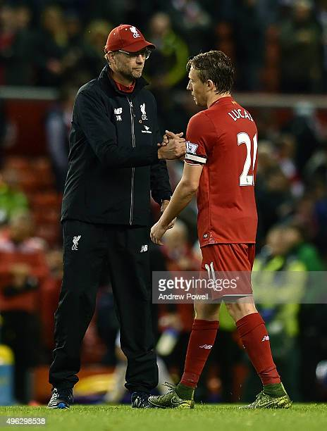 Jurgen Klopp manager of Liverpool shows his appreciation Lucas Leiva at the end of the Barclays Premier League match between Liverpool and Crystal...