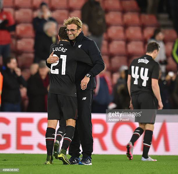 Jurgen Klopp manager of Liverpool shows his appreciation to Lucas Leiva at the end during the Capital One Cup Quarter Final match between Southampton...