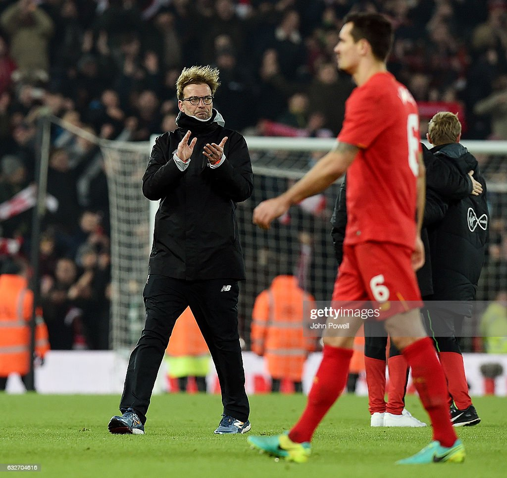 Jurgen Klopp manager of Liverpool shows his appreciation to the fans at the end of the EFL Cup Semi-Final second leg match between Liverpool and Southampton at Anfield on January 25, 2017 in Liverpool, England.