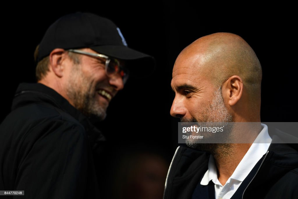 Jurgen Klopp, Manager of Liverpool smiles as Josep Guardiola, Manager of Manchester City looks on prior to the Premier League match between Manchester City and Liverpool at Etihad Stadium on September 9, 2017 in Manchester, England.