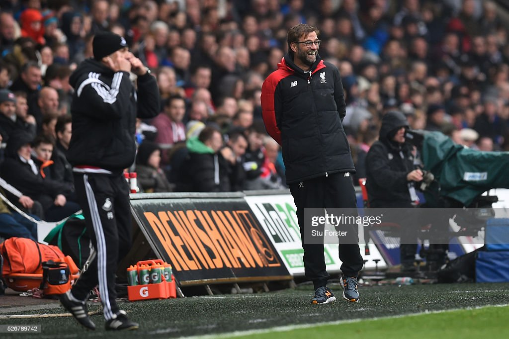 Jurgen Klopp (R), manager of Liverpool smiles with <a gi-track='captionPersonalityLinkClicked' href=/galleries/search?phrase=Francesco+Guidolin&family=editorial&specificpeople=770478 ng-click='$event.stopPropagation()'>Francesco Guidolin</a>, manager of Swansea City during the Barclays Premier League match between Swansea City and Liverpool at The Liberty Stadium on May 1, 2016 in Swansea, Wales.