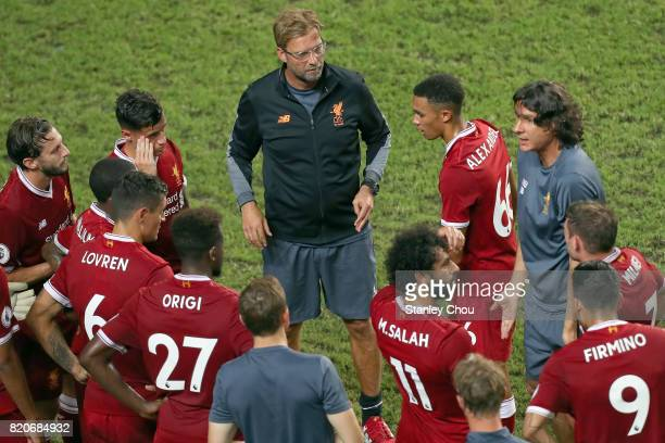 Jurgen Klopp Manager of Liverpool speaks to his players during the Premier League Asia Trophy match between Liverpool FC and Leicester City FC at...