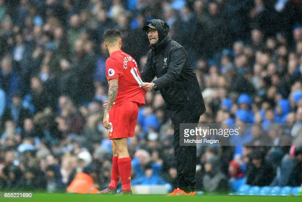 Jurgen Klopp Manager of Liverpool speaks to Philippe Coutinho of Liverpool during the Premier League match between Manchester City and Liverpool at...