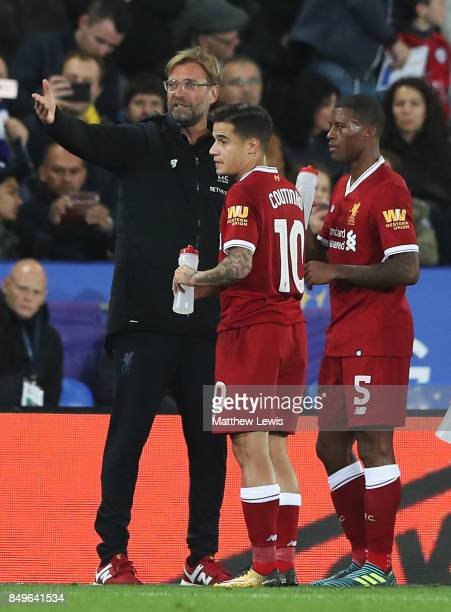 Jurgen Klopp Manager of Liverpool speaks with Philippe Coutinho of Liverpool and Georginio Wijnaldum of Liverpool during the Carabao Cup Third Round...