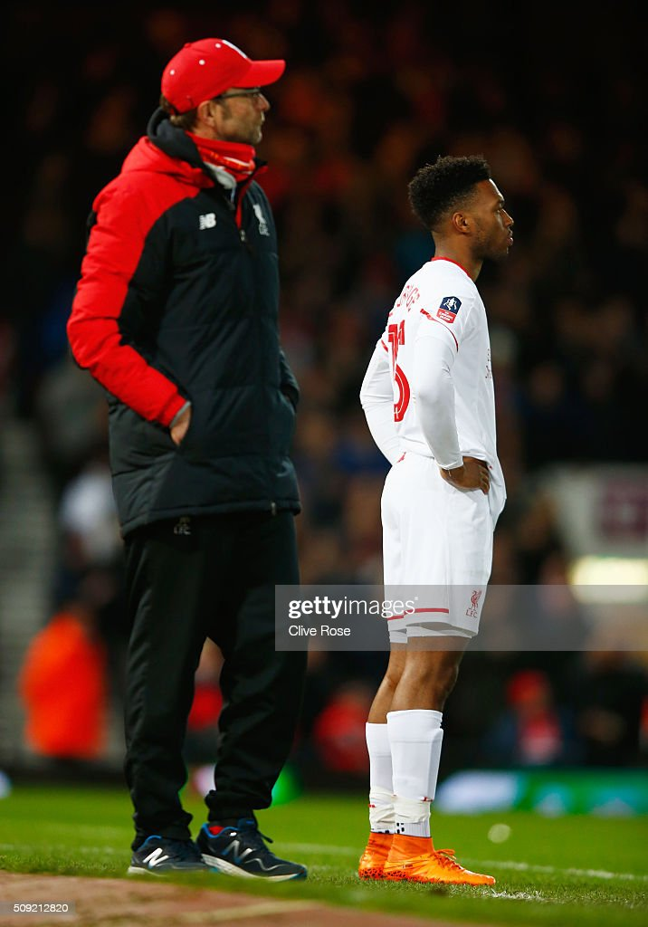 Jurgen Klopp, manager of Liverpool stands alongside substitute <a gi-track='captionPersonalityLinkClicked' href=/galleries/search?phrase=Daniel+Sturridge&family=editorial&specificpeople=677270 ng-click='$event.stopPropagation()'>Daniel Sturridge</a> of Liverpool during the Emirates FA Cup Fourth Round Replay match between West Ham United and Liverpool at Boleyn Ground on February 9, 2016 in London, England.