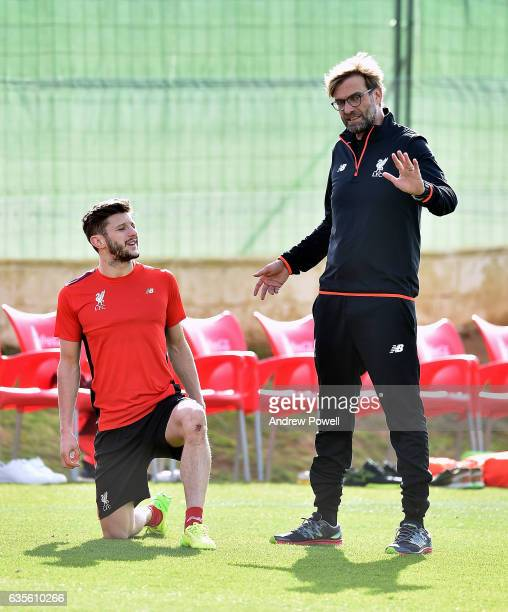 Jurgen Klopp manager of Liverpool talking with Adam Lallana during a training session at La Manga on February 16 2017 in La Manga Spain