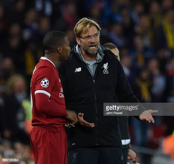 Jurgen Klopp manager of Liverpool talking with Daniel Sturridge during the UEFA Champions League group E match between Liverpool FC and NK Maribor at...