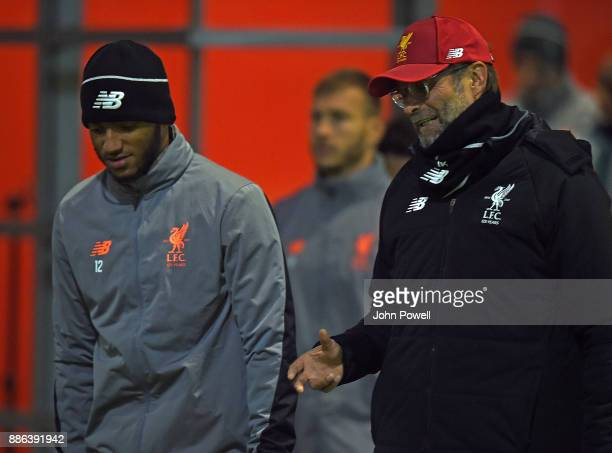Jurgen Klopp manager of Liverpool talking with Joe Gomez during a training session at Melwood Training Ground on December 5 2017 in Liverpool England