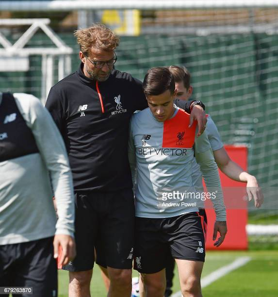 Jurgen Klopp manager of Liverpool talking with Philippe Coutinho during a training session at Melwood Training Ground on May 5 2017 in Liverpool...