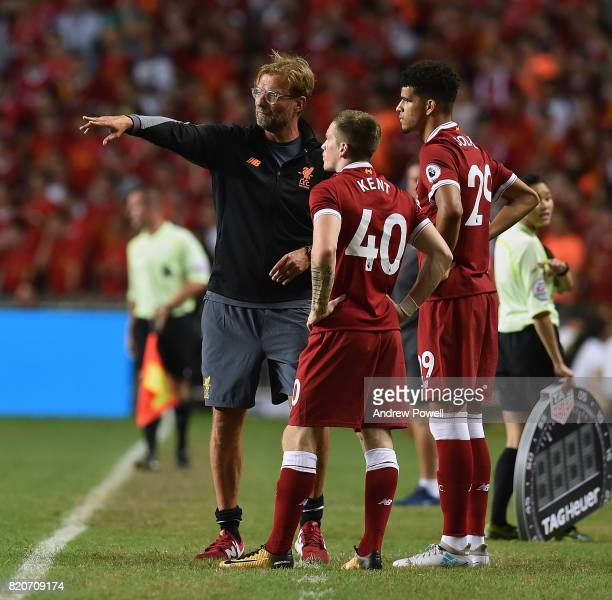 Jurgen Klopp manager of Liverpool talking with Ryan Kent and Dominic Solanke of Liverpool during the Premier League Asia Trophy match between...