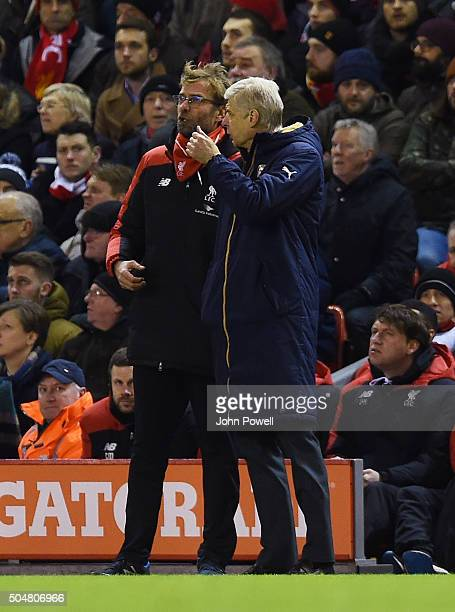 Jurgen Klopp manager of Liverpool talks to Arsene Wenger manager of Arsenal during the Barclays Premier League match between Liverpool and Arsenal at...
