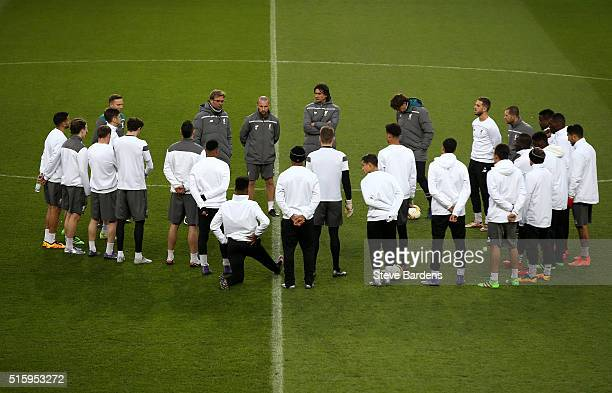 Jurgen Klopp Manager of Liverpool talks to his players during a training session ahead of the UEFA Europa League round of 16 second leg match between...