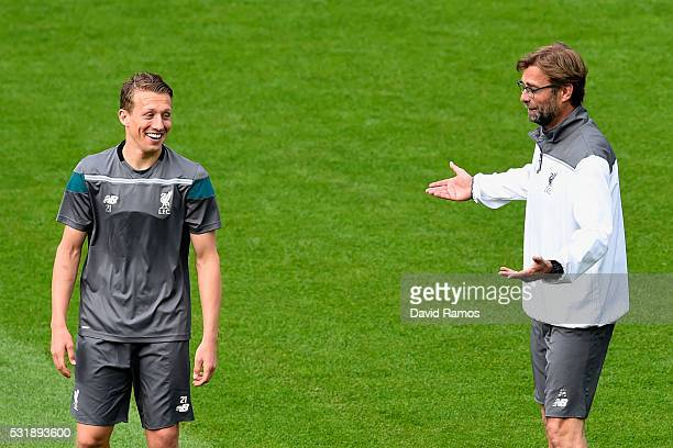 Jurgen Klopp manager of Liverpool talks to Lucas Leiva during a Liverpool training session on the eve of the UEFA Europa League Final against Sevilla...