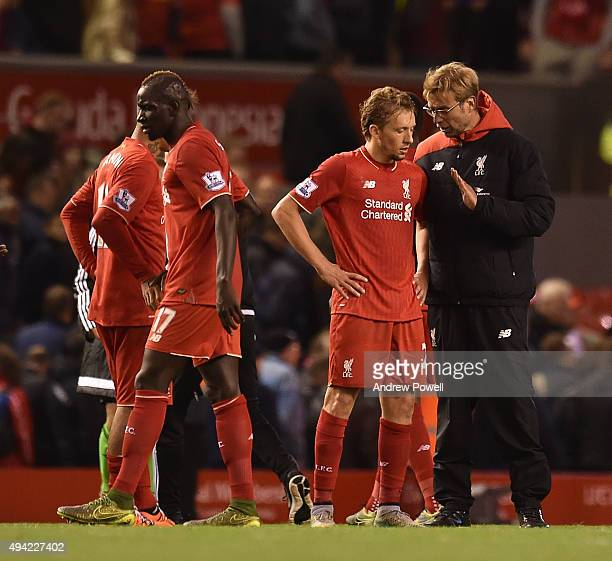 Jurgen Klopp manager of Liverpool talks to Lucas Leiva of Liverpool at the end of the Barclays Premier League match between Liverpool and Southampton...