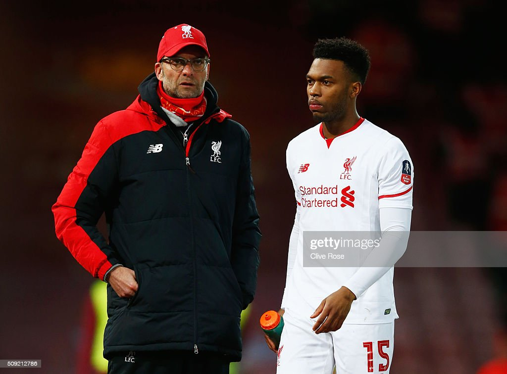Jurgen Klopp, manager of Liverpool talks to substitute <a gi-track='captionPersonalityLinkClicked' href=/galleries/search?phrase=Daniel+Sturridge&family=editorial&specificpeople=677270 ng-click='$event.stopPropagation()'>Daniel Sturridge</a> of Liverpool during the Emirates FA Cup Fourth Round Replay match between West Ham United and Liverpool at Boleyn Ground on February 9, 2016 in London, England.