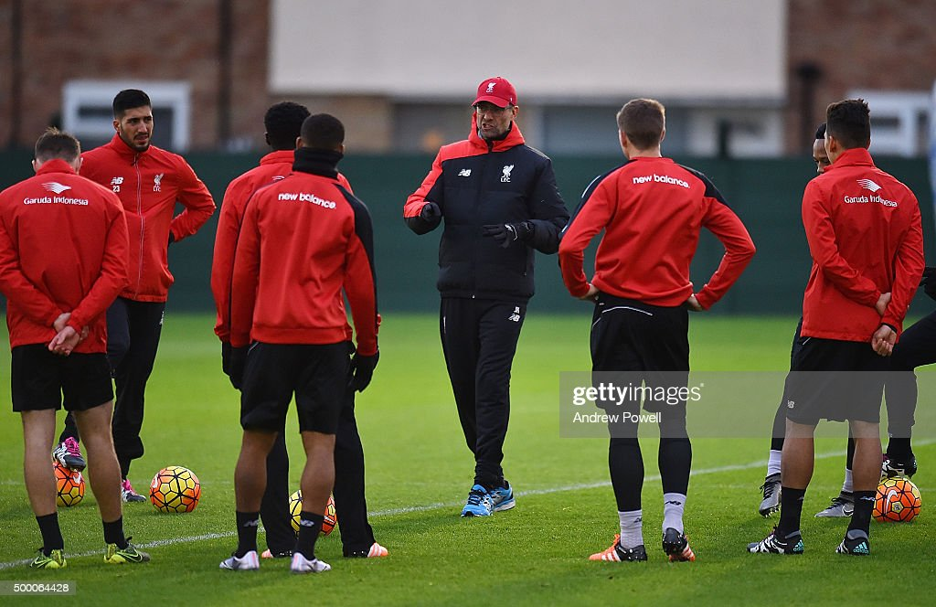 Jurgen Klopp manager of Liverpool talks with his team during a training session at Melwood Training Ground on December 5, 2015 in Liverpool, England.