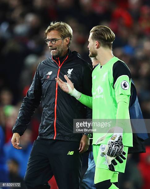 Jurgen Klopp Manager of Liverpool talks with Loris Karius of Liverpool after the Premier League match between Liverpool and Manchester United at...
