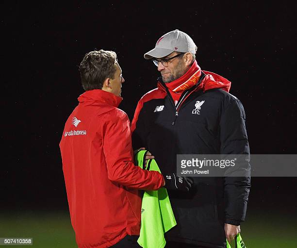 Jurgen Klopp manager of Liverpool talks with Lucas Leiva during a training session at Melwood Training Ground on January 29 2016 in Liverpool England