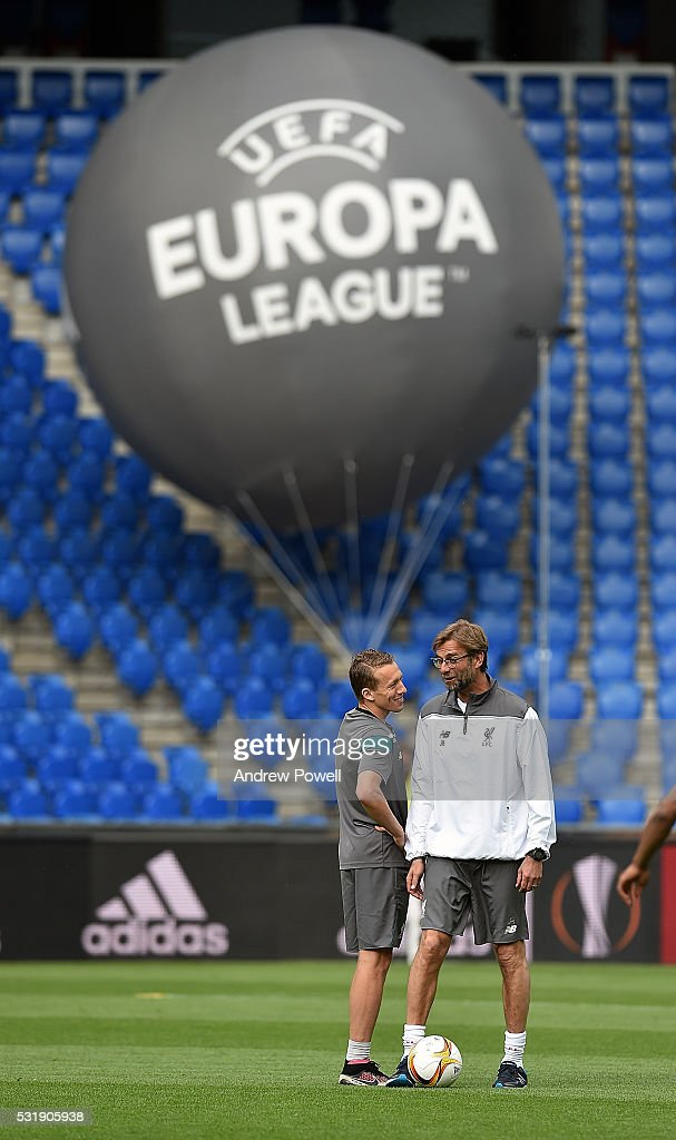 Jurgen Klopp manager of Liverpool talks with Lucas Leiva during the training session ahead of the UEFA Europa League Final at St. Jakob-Park on May 17, 2016 in Basel, Basel-Stadt.
