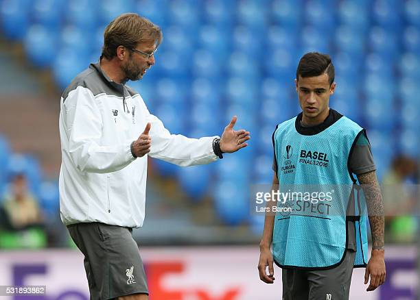 Jurgen Klopp manager of Liverpool talks with Philippe Coutinho during a Liverpool training session on the eve of the UEFA Europa League Final against...