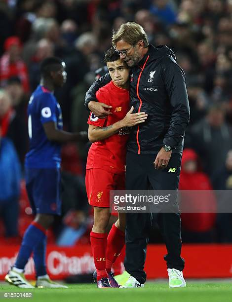 Jurgen Klopp Manager of Liverpool talks with Philippe Coutinho of Liverpool after the Premier League match between Liverpool and Manchester United at...