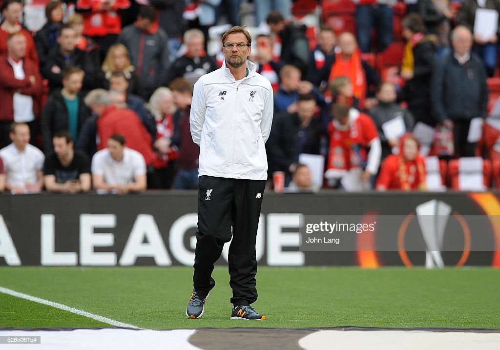 Jurgen Klopp manager of Liverpool watches the teams warm up before the UEFA Europa League Semi Final: Second Leg match between Liverpool and Villarreal CF at Anfield on May 05, 2016 in Liverpool, England.