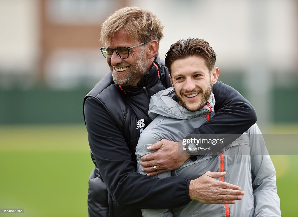 Jurgen Klopp manager of Liverpool with Adam Lallana during a training session at Melwood Training Ground on April 29, 2017 in Liverpool, England.