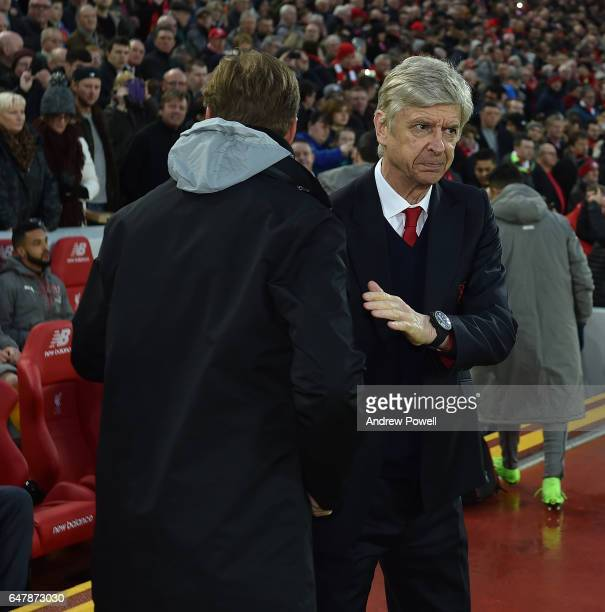 Jurgen Klopp Manager of Liverpool with Arsne Wenger Manager of Arsenal during the Premier League match between Liverpool and Arsenal at Anfield on...