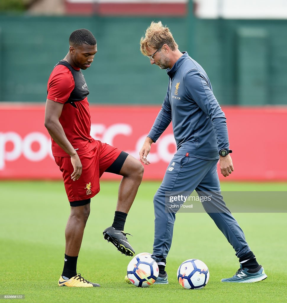Jurgen Klopp manager of Liverpool with Daniel Sturridge during a training session at Melwood Training Ground on August 17, 2017 in Liverpool, England.