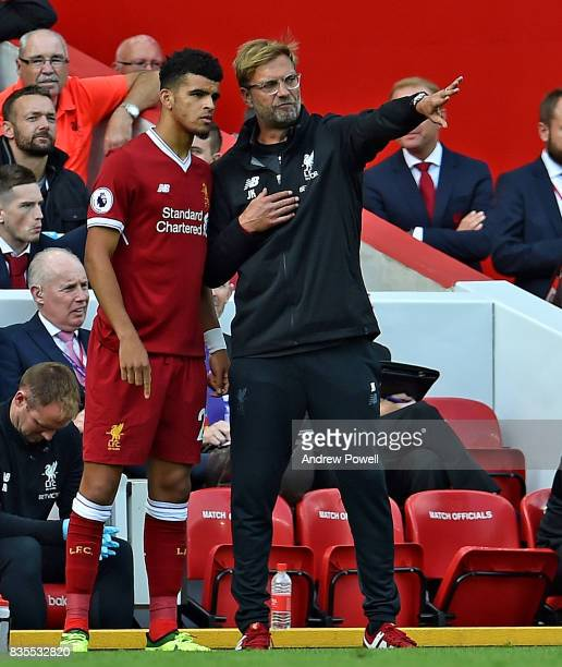 Jurgen Klopp Manager of Liverpool with Dominic Solanke during the Premier League match between Liverpool and Crystal Palace at Anfield on August 19...