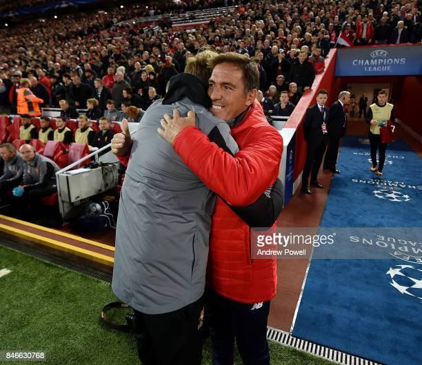 Jurgen Klopp manager of Liverpool with Eduardo Berizzo manager of Eduardo Berizzo before the UEFA Champions League group E match between Liverpool FC...