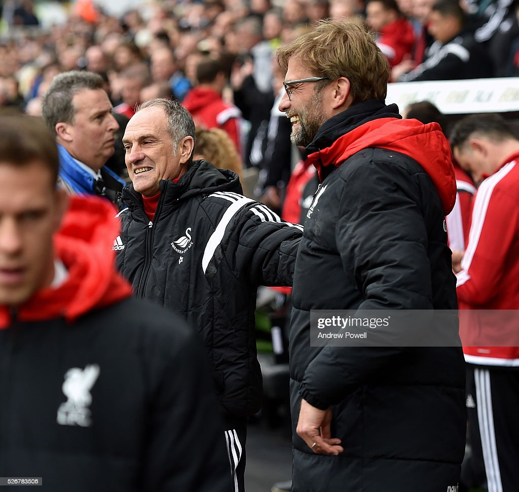 Jurgen Klopp manager of Liverpool with Francesco Guideline manager of Swansea City before a Premier League match between Swansea City and Liverpool at the Liberty Stadium on May 01, 2016 in Swansea, Wales.